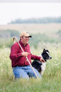 Jared Epp with his herding dog at Beaver Creek Meewasin